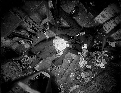 In this Nov 24, 1915, the bodies of elevator operator Robert Green, left and Jacob Jagendorf, a building engineer, lie at the bottom of an elevator shaft in New York. Over 870,000 photos from an archive that exceeds 2.2 million images have been scanned and made available online, for the first time giving a global audience a view of a rich collection that documents life and sometimes death in New York City. (AP Photo/New York City Municipal Archives, NYPD Evidence Collection) MANDATORY CREDIT